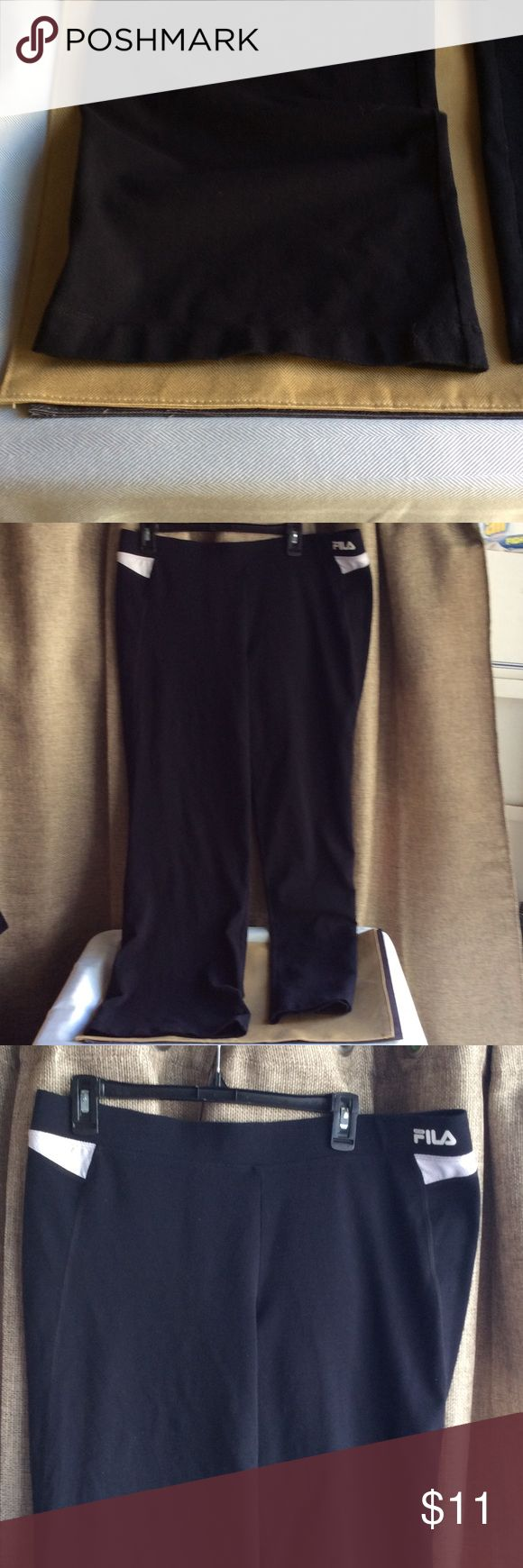 FILA black w/white boot cut yoga pants Sz XL Black yoga pants are wide boot cut at bottom yard FILA. Have white mesh fabric detailing at waist sides. Are 55 cotton/38 poly/8 spandex. Are not brand new, customer returned to obtain straight ankle fit instead. Great condition! Pants Wide Leg