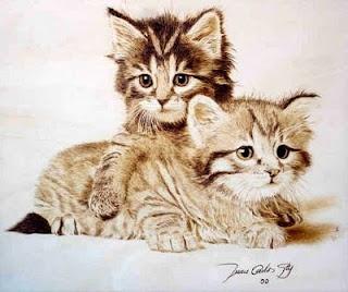 woodburned kitties..adorable  Spanish artist Juan Carlos González