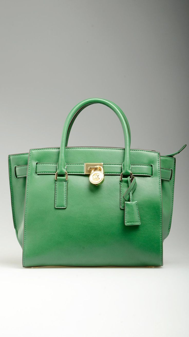 Green leather Hamilton Traveler tote bag featuring top zip, tote handles, adjustable and removable crossbody strap, monogram lining, four inner open pockets and a zippered one, protective studs, golden hardware, logoed padlock detailing at front, 10.2'' x 5.3'' x 8.6'', 100% leather.