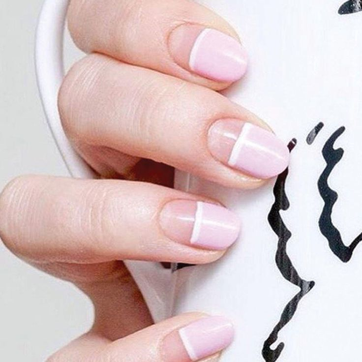 Sweet and subtle, this negative space nail design is perfect to take to the office or a summer party. Bonus points for being pretty easy to DIY.
