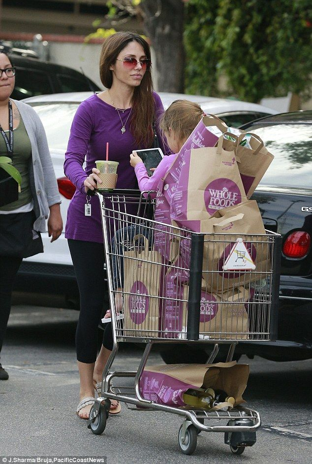 Mel Gibson's ex Oksana Grigorieva shops at pricey market with daughter Lucia... just weeks after filing for bankruptcy.