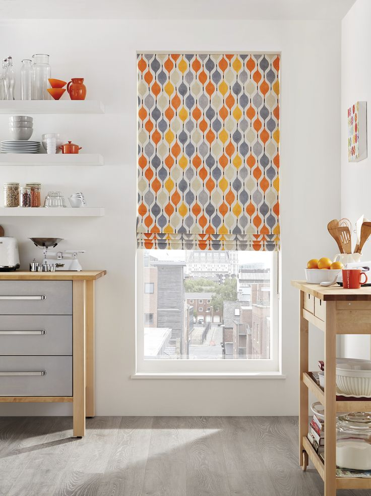 Add a splash of colour! Brighten up those neutral tones with an orange Roman Blind from Starlight Blinds.