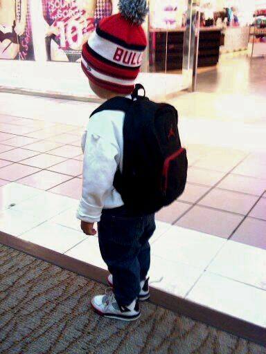 Instead of jays hell be wearin vans with a vans backback. Like the hat & sweatshirt look with them jeans too
