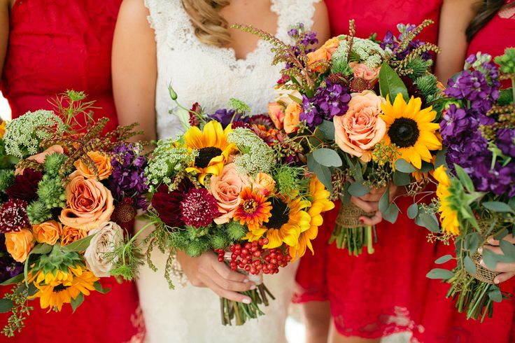 A gorgeous wedding with sunflower bouquets and red bridesmaid dresses!! ©Jennefer Wilson