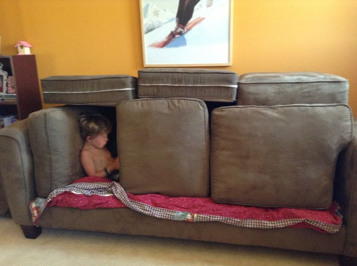 Sofa Fort.. love this except the fact that the kid is playing on a phone.