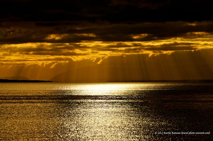 It is raining gold!!  Lausanne, Switzerland over Geneva Lake (also known as Lac Leman) and Swiss Alps