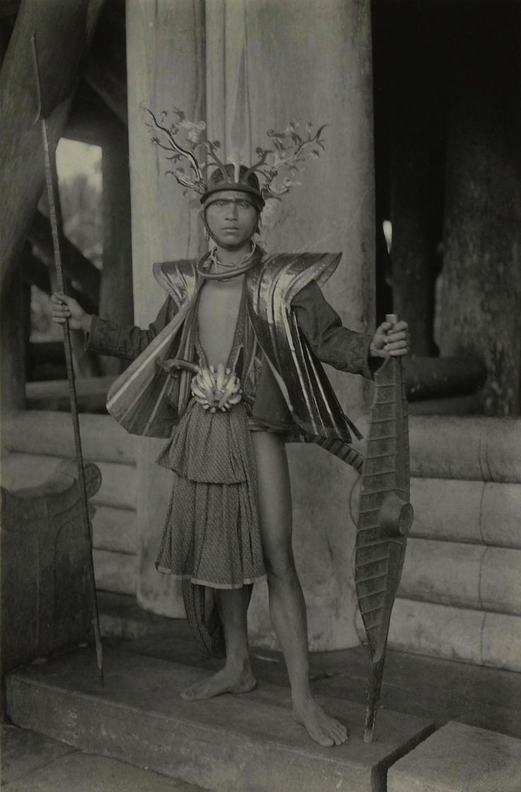 A. Kruisheer ~ Man from Bawomataloea in the south of Nias Island in festive dress, circa 1906-1905 (Kerncollectie Fotografie, Museum Volkenkunde)