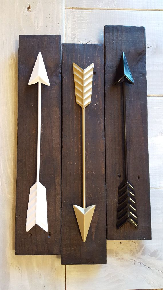 Gold, Black, and White Arrows on Reclaimed Wood: https://www.etsy.com/listing/269910683/metal-arrow-wall-decor-on-dark-reclaimed