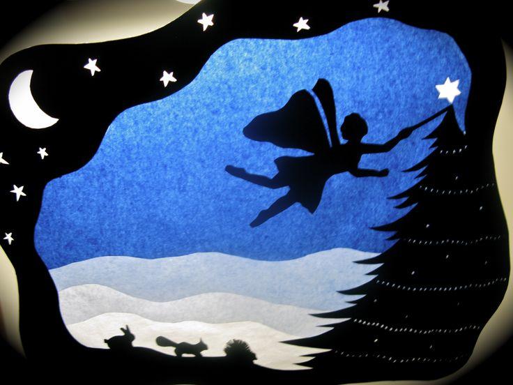winter transparency - fairy 'lighting' star on tree