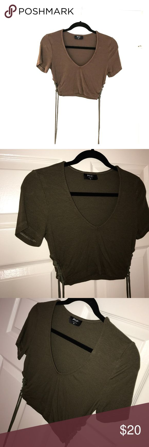 NAST GAL RIBBED OLIVE CROP TOP SIZE MEDIUM. NAST GAL RIBBED OLIVE CROP TOP SIZE MEDIUM. Side ties. No tags, never worn, perfect condition. V-neck tee Nasty Gal Tops Crop Tops