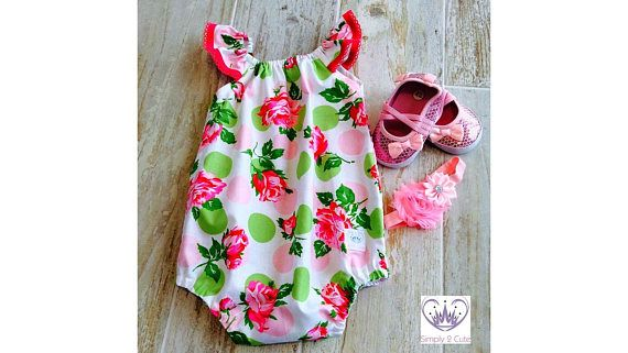 Flutter sleeve, floral cotton playsuit with snaps at the crotch to make it easy and practical for diaper changing. This romper is roomy enough for both cloth or disposable diapers. The elasticized leg openings are covered to protect babys skin. This wonderfully cool cotton playsuit is perfect worn on its own or team it with tights or a skirt for a complete outfit. This item is made to order. Available in sizes Newborn - 2 years. Size Age Childs Height Playsuit Length 0000 Newborn 56cm /...