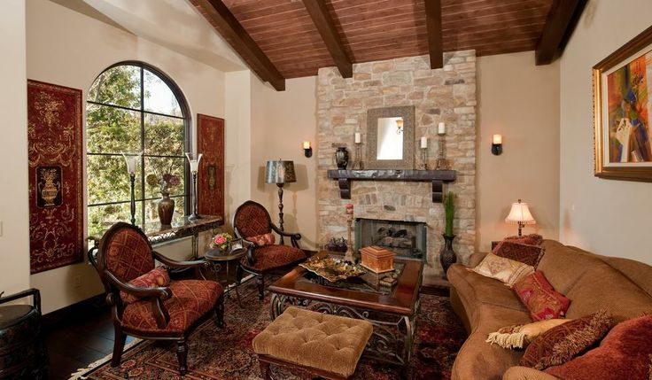 Tuscan Living Room Warm Colors Wood Beam Ceiling And Stone Fireplace Li