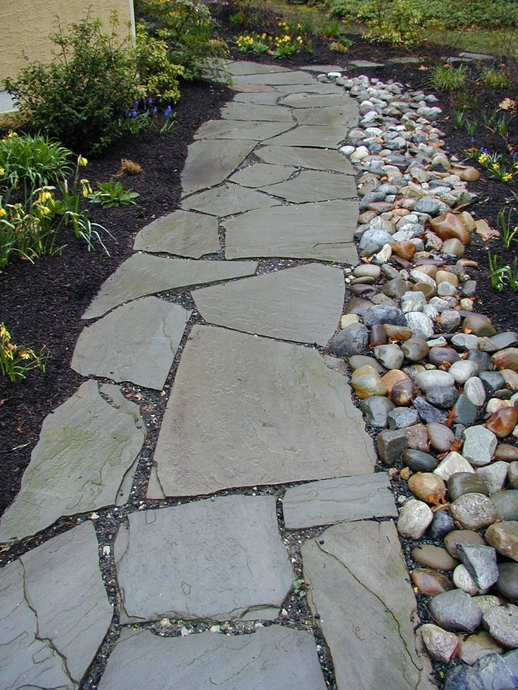 22 beautiful river rock landscaping ideas home and gardens - Garden Ideas Using Stones