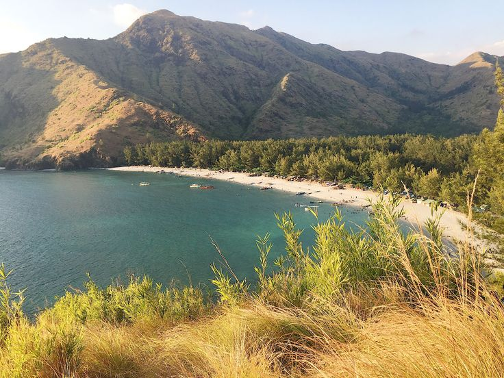 Anawangin Cove, also known as 'the little tent city', drenched with beautiful green pine trees and miles of white sand; a good reason to bum around in the sun.