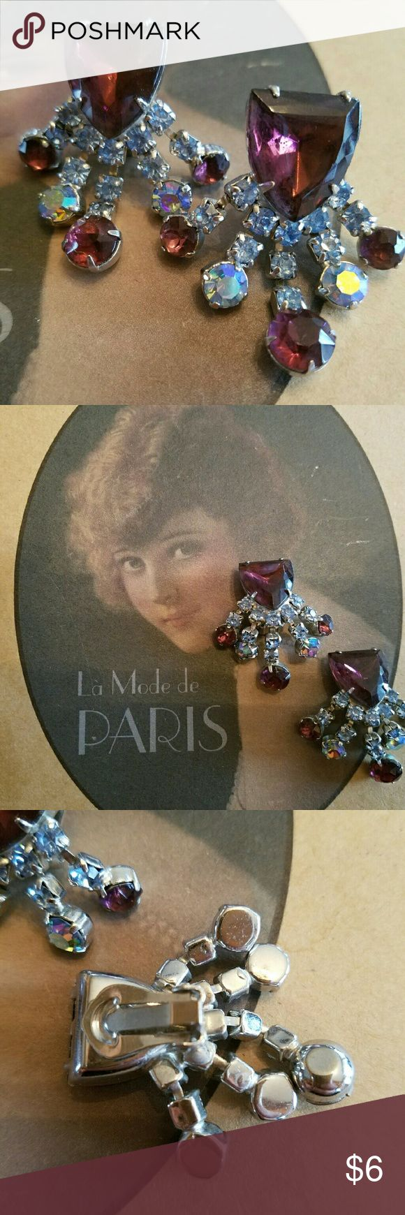 """She never danced alone"" Vintage clip-on earrings. Large cranberry colored crystals and ab crystals make these sparkle. Silver setting. Earrings measure approc 1 1/2"" from top to bottom. All stones intact. Jewelry Earrings"