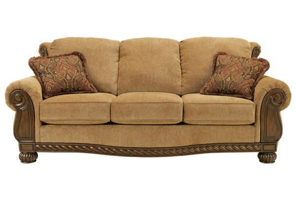 Treat yourself to luxury. Overscaled for comfort, this sofa features loose cushions with welt trim, Charles of London arms and fluted wood feet. Five fringed, feather down throw pillows add flare, while the eight–way hand–tied construction and 1.8–density foam cushions ensure great quality. Available with a 97″ or 87″ length.