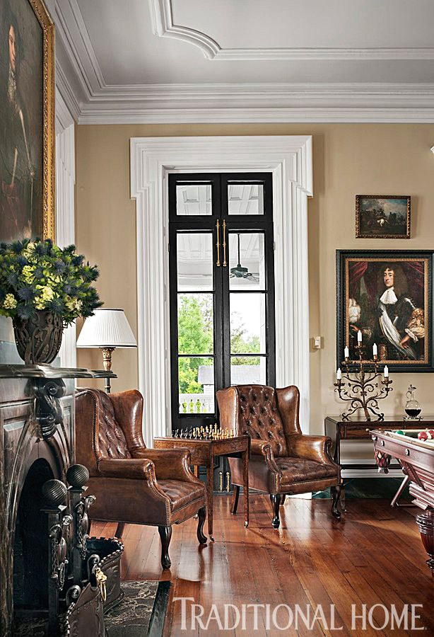 A pair of tufted-leather wing chairs, circa 1930, evoke a British men's club. - Photo: Durston Saylor / Design: Susanne Lichten Csonger