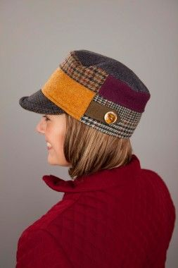 Woman's billed hat made of recycled woven tweeds, plaids and herringbones by Baabaazuzu. American Made. 2013 Buyers Market of American Craft. americanmadeshow.com