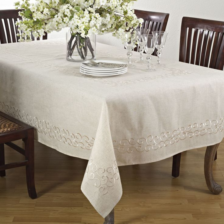 Dress your table in comtemporary style with Saro Lifestyle's embroidered scroll design table toppers and tablecloths. These linens are perfect for everyday entertaining.