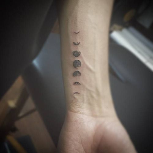 Lunar phases on the left forearm. Tattoo artist: East