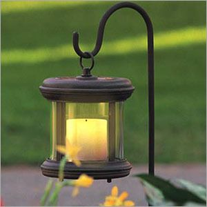 Light your pathway with solar lanterns, that look like candles.