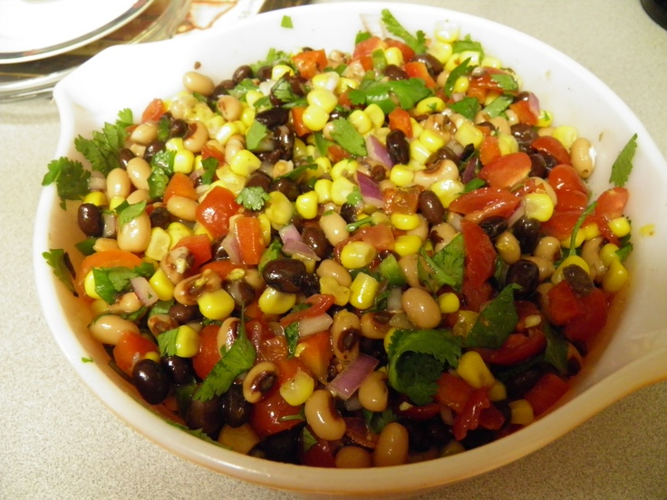 Alisha's Texas caviar:  1 can of drained black-eyed peas  1 can of drained corn  1 can of rinsed and drained black beans   2/3 cup diced fresh tomatoes   1/2 cup chopped red bell pepper  1/3 cup chopped red onion  1 med. diced jalapeño - seeds removed   Juice of one large lime  1/3 cup chopped cilantro  1/2 to 2/3 cup Brianna's Santa Fe blend salad dressing or Zesty Italian or homemade.  Combine all ingredients and let marinate a few hours before serving.    Serve with baked Tostito scoops.