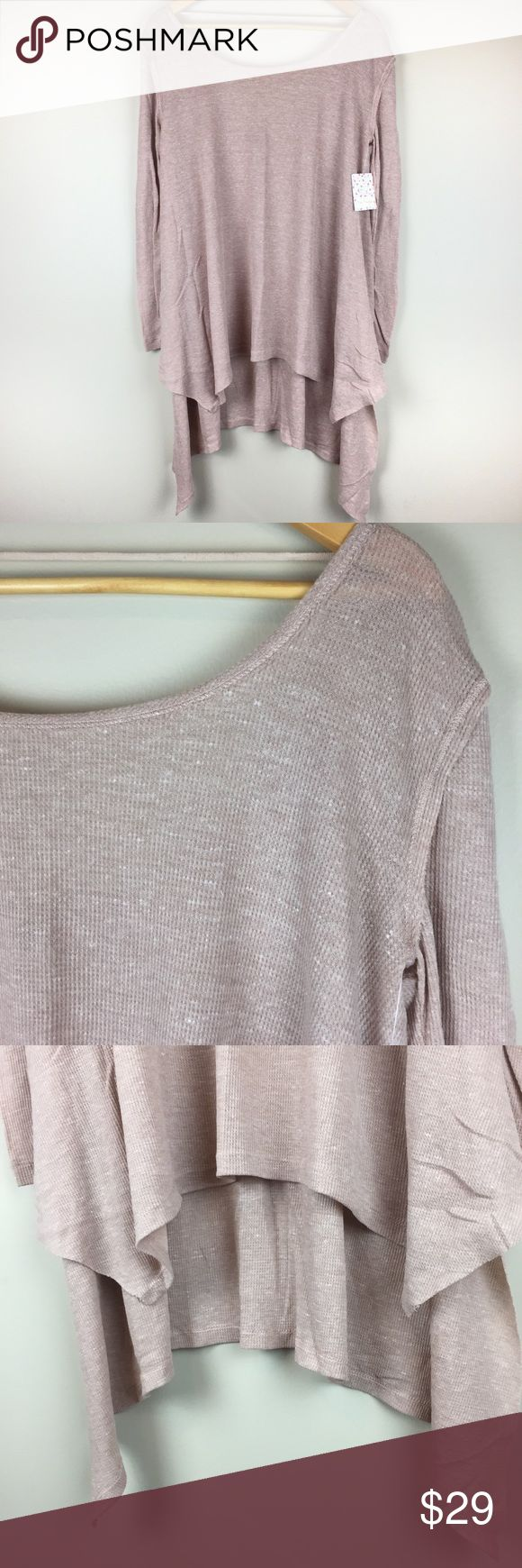 """Free People Shirt Incredible Tee Thermal Free People Women's Shirt Size Small Incredible Tee Lightweight Thermal NWT $78  Brand new Free People """"We The Free"""" Incredible Tee in the color latte (brownish beige). Women's size small, however, this is a very relaxed/oversized fit—please see measurements! Distressed lightweight knit with scoop neck in front and back and high-low hem. Smoke-free home.  APPROXIMATE measurements: Armpit to armpit 21.5"""" Length (shortest) 27.5"""" Length (longest) 35""""…"""