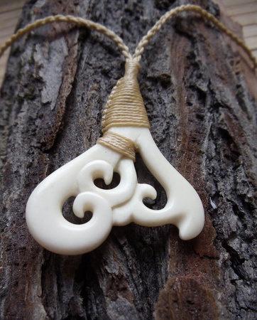 Maori whale tale pendant