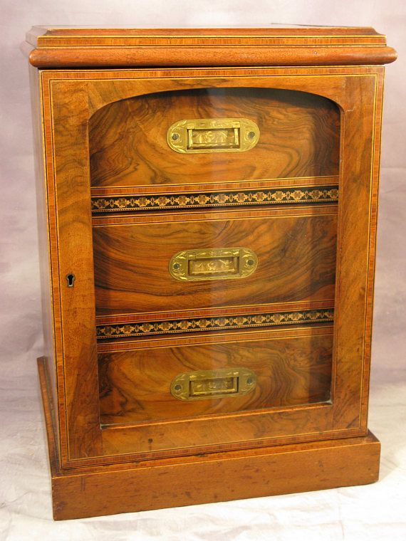 Antique Early Edwardian Period Figured Walnut Tunbridge Inlaid Glaze Front Cigar Smokers Cabinet Circa 1890-1910 A stunning late Victorian to early Edwardian period desk top cigar smokers cabinet constructed in beautifully grained walnut with Tunbridge inlay design and string borders  The glazed door opens to reveal a fully fitted interior consisting of three drawers with movable separators for cigar storage finished with beautifully engraved brass inset handles.  In stunning condition minus…