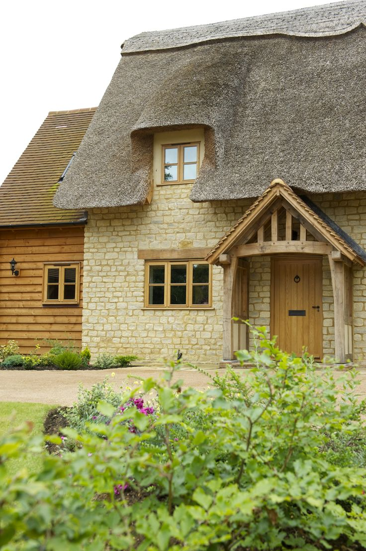 Border Oak - stone cottage with thatch roof