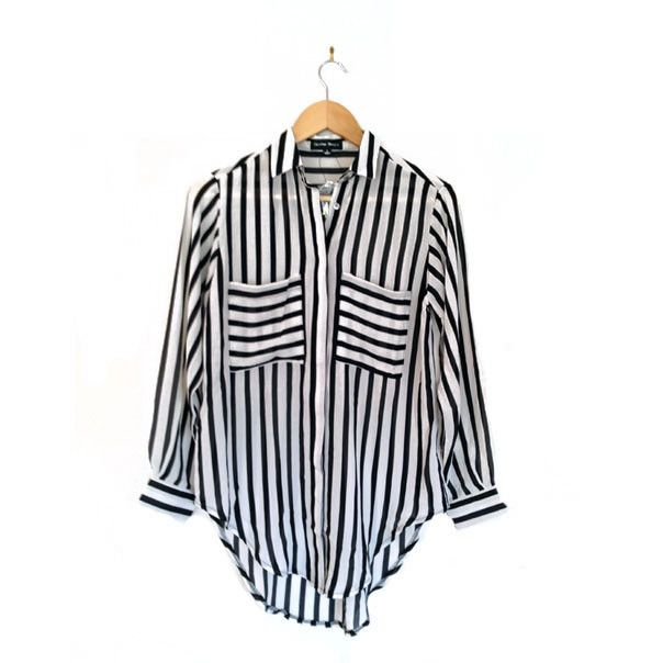 Loose fit, black and white striped top. Dress with leggings and flats for day or heels for night.
