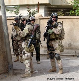 """Navy SEALs shortly after shooting begins in Mulaab. Note the wooden-butt 40 mm M-79 grenade launcher, affectionately called a """"Thumper."""" On the right is Mike Monsoor, posthumously nominated for the Congressional Medal of Honor after throwing himself on a grenade."""