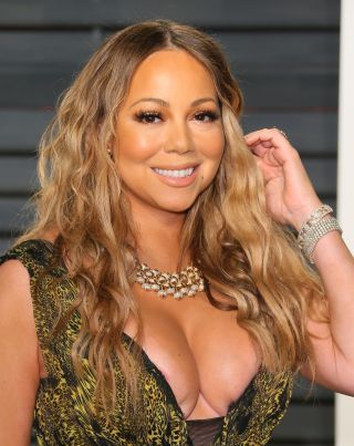 """""""I never thought I would have babies with someone and then get divorced. Like, 'Oh, great job. Repeat your past.' But life happens. And it was supposed to happen."""" – Mariah Carey on divorce from Nick Cannon"""