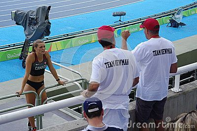 Alysha Newman, current Canadian National record holder of 4.61m in the women's pole vault, consulting her coaches during Rio2016 Olympics. Picture taken on Aug 16, 2016