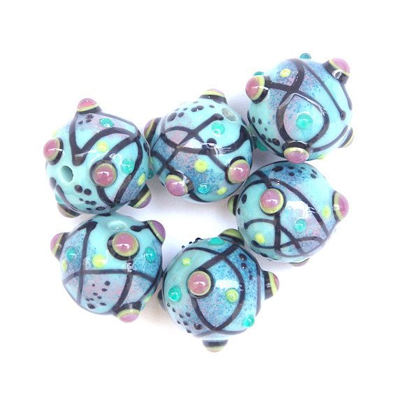 lofty thoughts round lampwork glass bead set in turquoise black and orchidu2026
