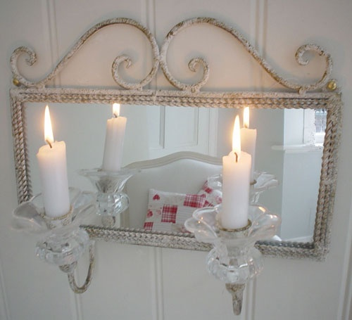 The Christopher Lowell Show   The Swedish mounted candles in front of mirrors to double the light during the long dark winters.