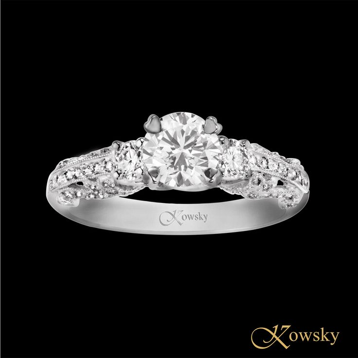 Virtue - If beauty is the mark God sets upon virtue, the baroque lines and elegant design of this gorgeous engagement ring will surely proclaim the virtue of your love to one and all.  Diamonds, Platinum
