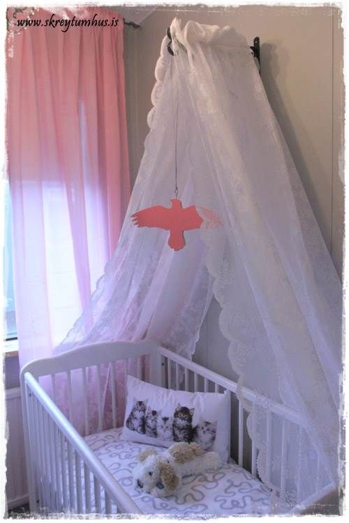 DIY Bed canopy for a crib (Made out of two curtains that are sewn together  and laid over an outdoor flower pot holder, curtains fastened too the  flower pot ...