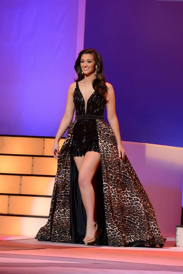 Victoria Piekut, International Junior Miss Teen 2015, looked fun and funky in this high-low romper outfit during the International Junior Miss Teen fun fashion competition. Patterns are definitely in this pageant season, and she rocked the cheetah look perfectly!  Where to Wear it:   This outfit is crazy fun and super unique, which means it's perfect for fun fashion. It takes a risk-taker to wear this much cheetah print on stage, and Victoria showed us that she's confident enough for it!
