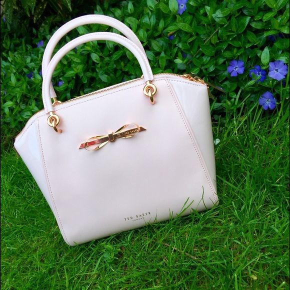Ted Baker handbag Saw this displayed in the Ted Baker store window. I thought I HAD to have it. I just never used it. Mint, flawless condition. Light pink color with rose gold details. Gorgeous bag. Ted Baker Bags Shoulder Bags