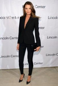 Black pantsuit, pant suit with purse, high heels (pumps). Stylish business look. Learn what to wear this fall, 2015 >>> http://justbestylish.com/what-to-wear-this-fall/