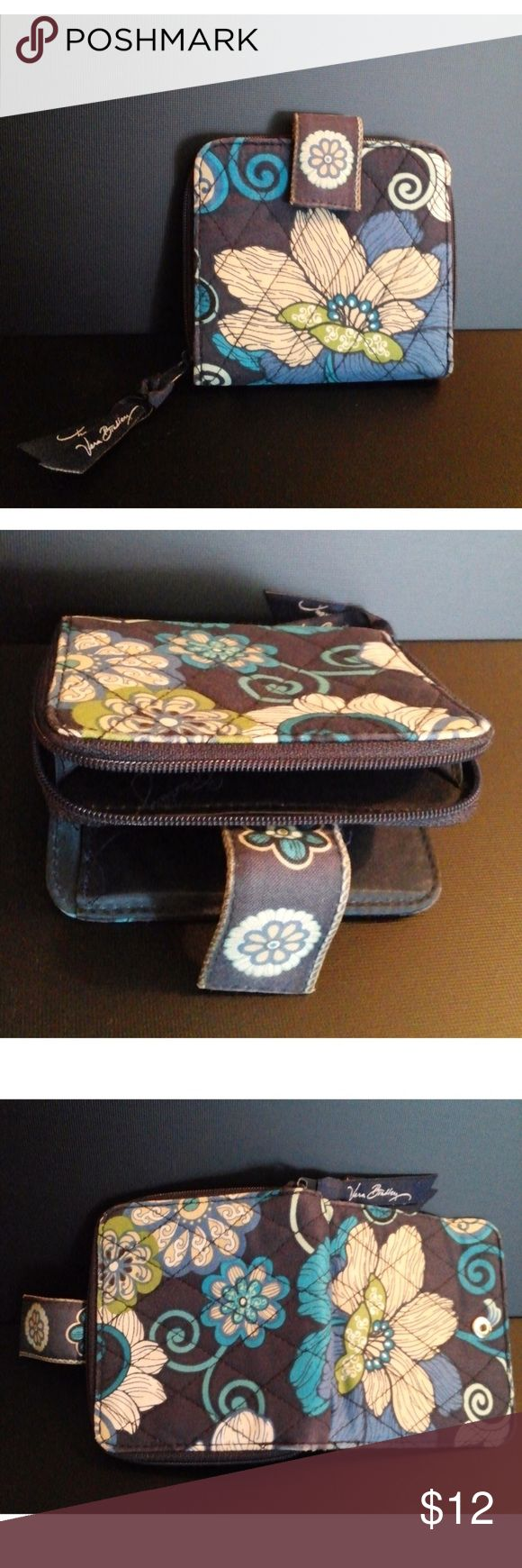 """Vera Bradley Mini Zip Wallet in Mod Floral Blue An adorable wallet with lots of compartments, slots for bills and cards, a clear ID window and a zippered, gusseted coin purse.   *Finished with a tab closure *Mod Floral Blue print *Measures approximately 4"""" x 4""""  Used; Excellent Condition Vera Bradley Bags Wallets"""