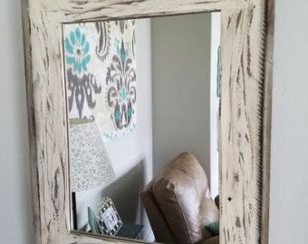 This beautiful product features a reclaimed wood panel with an 8x10 picture frame displayed on top. The picture frame is easily removable for access to change your family photos. The exterior dimensions of the wood panel are 16x20, just big enough to fill a fairly large void on your wall. This unique frame will add character to your home while at the same time displaying your valuable photos. Color of the wood will vary due to the nature of the reclaimed boards.