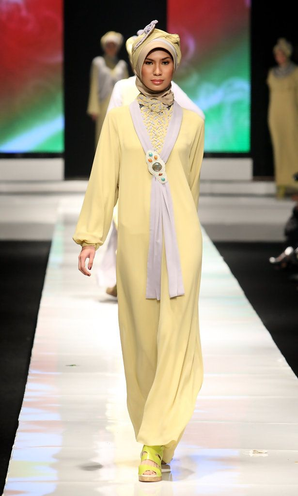 A model showcases designs on the runway by Jeny Tjahyawatii as part of APPMI Show 3 on day three of Jakarta Fashion Week 2009 at the Fashion Tent, Pacific Place on November 16, 2009 in Jakarta, Indonesia.