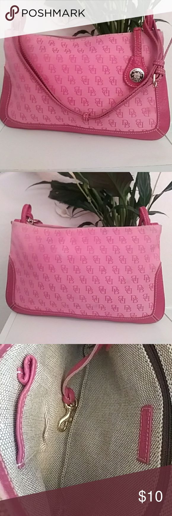 Final Price Drop! Pink Dooney and Bourke wristlet *Fading a little  * Has a few little marks on the front, but can.  probably come out in the wash easy.  ( I posted a pic of them )  If you have any questions let me know. :) Dooney & Bourke Bags Clutches & Wristlets