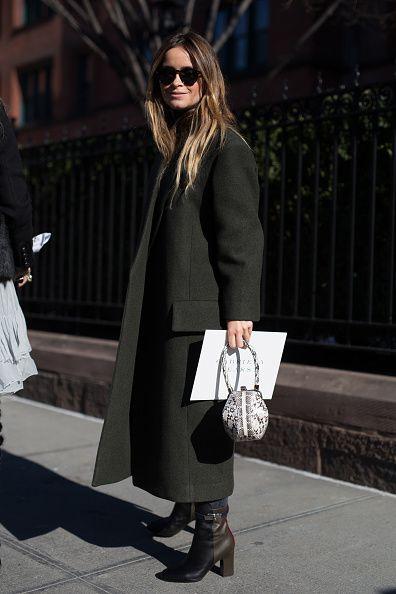 Miroslava Duma is seen attending Gabriela Hearst during New York Fashion Week wearing an army green coat on February 14 2017 in New York City #StreetStyle
