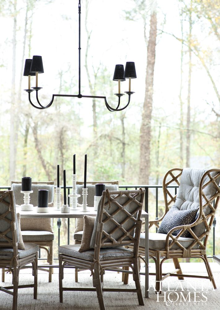 To allow for entertaining throughout the seasons, rattan dining chairs were sprayed with a protective coating, and the pressure-coated steel dining table's whitewashed wood top was sealed for additional durability.
