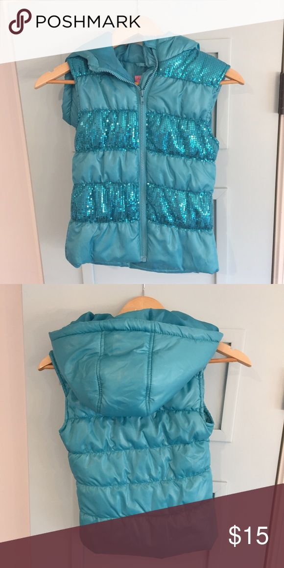 Girls size small puff vest turquoise sequin hooded Girls size small puff vest turquoise sequin hooded. No signs of wear. Looks brand new. Smoke free & pet free home. Offers considered🎉 check out my closet for additional items to bundle! HeartSoul Jackets & Coats Vests