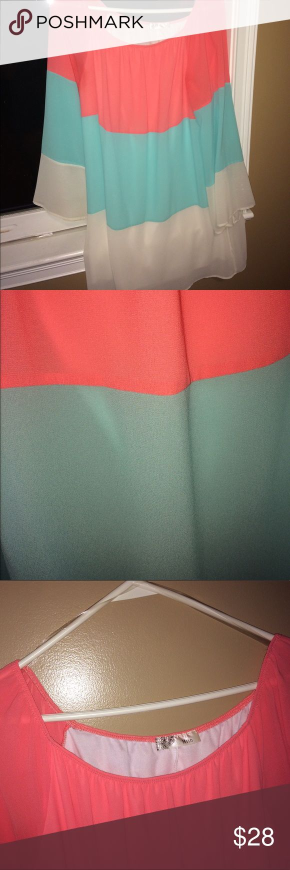 Three toned flowing blouse Coral, turquoise, and white full length sleeves Blouse perfect for a brunch or day out. Very comfortable and stylish. Perfect for more mature ladies. Hardly worn, still in great condition, no flaws or discoloration etc. 100% polyester. Miin Tops Blouses