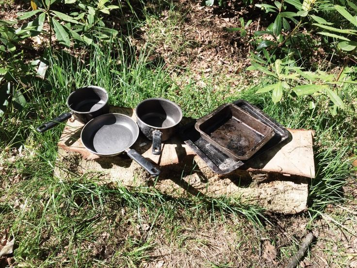 Pots and pans in a mud kitchen